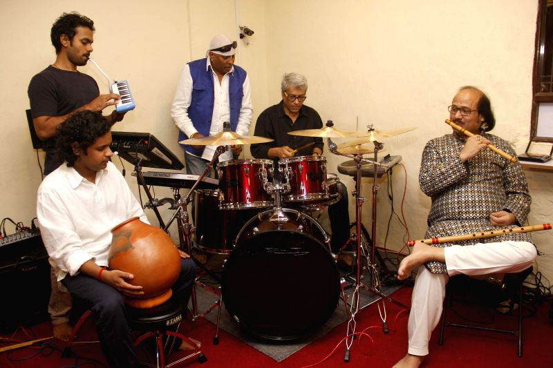 Percussionists Anandan Sivamani, Trilok Gurtu, flutist Ronu Majumdar and others perform during a press conference regarding `Vandan` in Mumbai, on Feb 6, 2015.