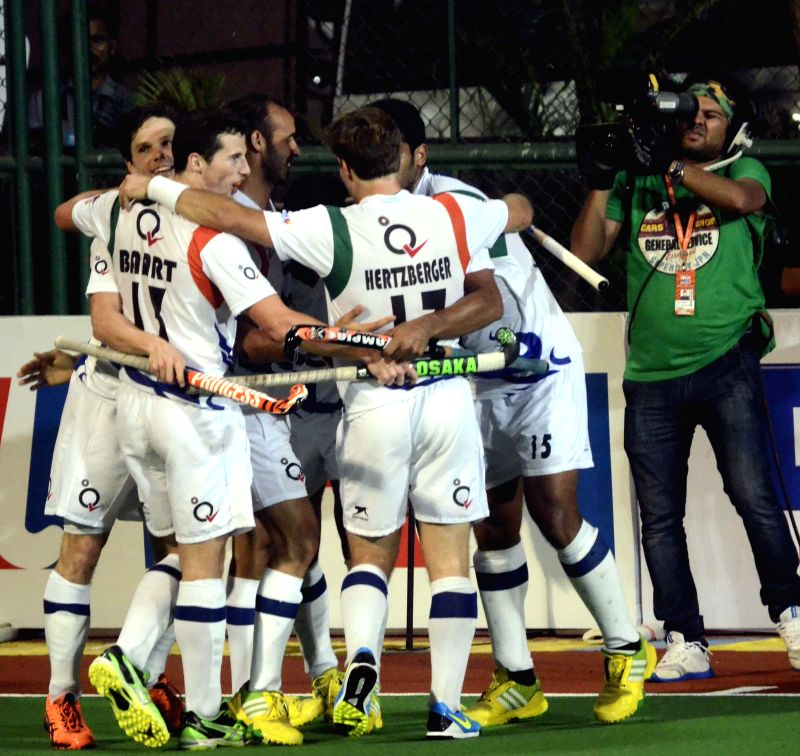 Players celebrate a goal during a Hockey India League match between Dabang Mumbai and Uttar Pradesh Wizards in Mumbai, on Feb 11, 2015.