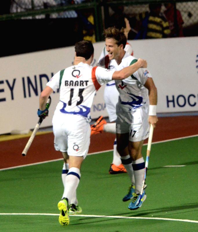 Players celebrate a goal during a Hockey India League match between Dabang Mumbai and Uttar Pradesh Wizards in Mumbai, on Feb 11, 2015.