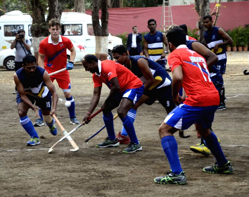 Players in action during a friendly match between Dabang Mumbai and Mumbai Police at Mahindra Hockey Stadium in Mumbai, on Jan 20, 2015.