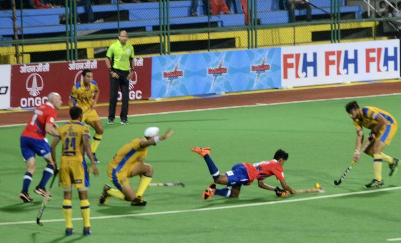 Players in action during a Hockey India League match between Dabang Mumbai and Punjab Warriors in Mumbai, on Jan 23, 2015.