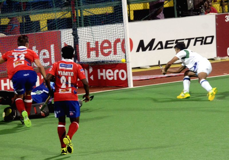 Players in action during a Hockey India League match between Dabang Mumbai and Uttar Pradesh Wizards in Mumbai, on Feb 11, 2015.