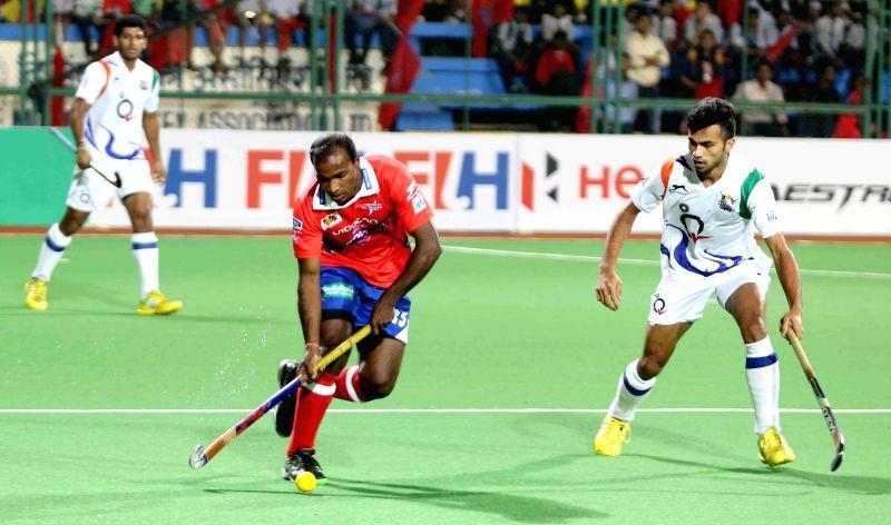Players in action during a Hockey India League match between Dabang Mumbai and Uttar Pradesh Wizards in Mumbai, on Feb 11, 2015.
