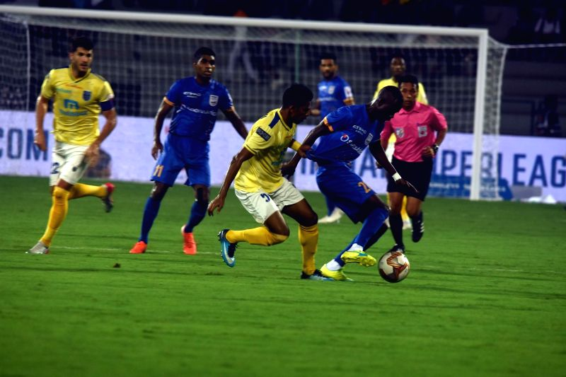 Mumbai: Players in action during Indian Super League (ISL) match between Mumbai City FC and Kerala Blasters at Andheri Sports Complex in Mumbai on Dec 5, 2019. (Photo: IANS)