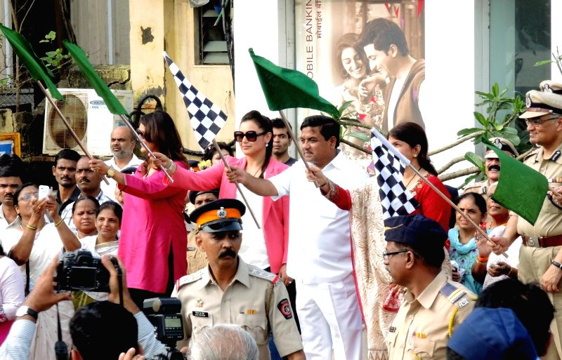 Mumbai Police Commissioner Rakesh Maria and actress Rani Mukherjee flag-off a contingent of 200 strong motorbike-borne, women beat marshals, who will be patrolling the streets looking out for ... - Rani Mukherjee