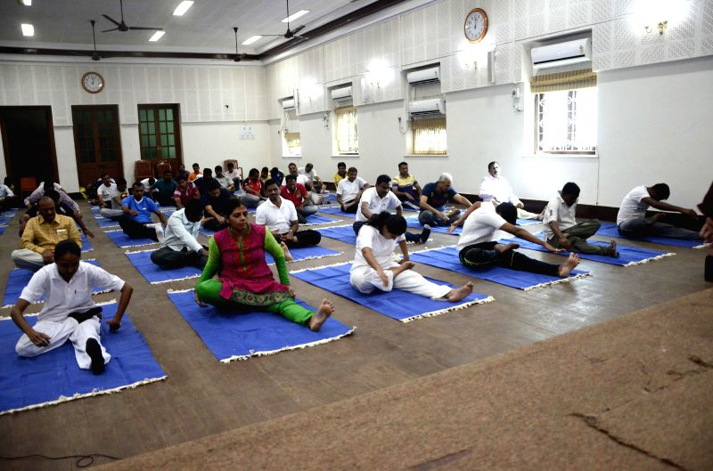 Police personnel during a yoga session in Mumbai on Jan 8, 2015.