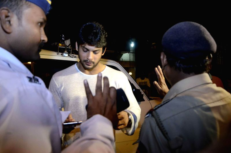 Police stops actor Siddharth Shukla on the new year's eve for security check in Mumbai, on Dec 31, 2014.