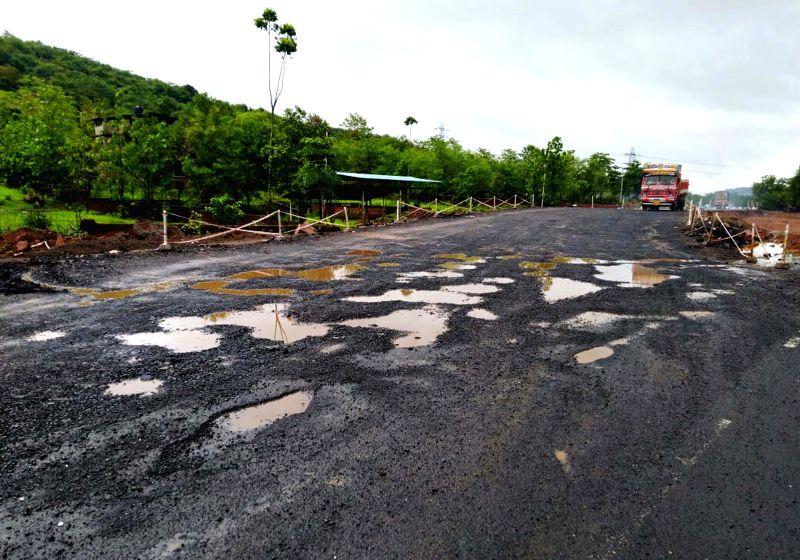 Mumbai: Potholes seen on Mumbai-Goa highway following rains, on June 28, 2019. (Photo: IANS)