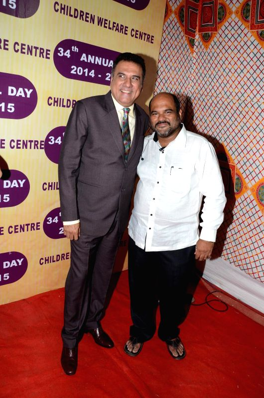 Prashant kashid with actor Boman Irani during the 34th annual day celebration of Children`s Welfare Centre High School in Mumbai, on Feb 15, 2015. - Boman Irani