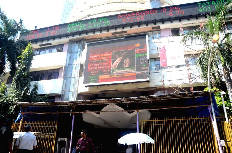 :Mumbai: Presentation of Budget 2018-19 being telecasted outside BSE in Mumbai on Feb 1, 2018. (Photo: IANS).