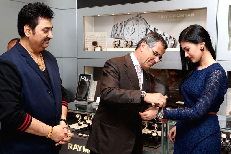 President Raymond Weil, Oliver Bernheim Global, singer Kumar Sanu and actress Amyra Dastur at Roaymnd Weil store in Mumbai on April 21, 2015.
