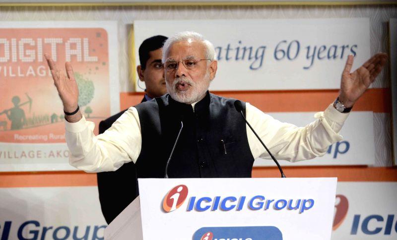Prime Minister Narendra Modi addresses during a programme organised to celebrate 60th anniversary of ICICI Bank in Mumbai, on Jan 2, 2015. - Narendra Modi