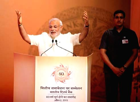 Prime Minister Narendra Modi at the Financial Inclusion Conference of RBI, in Mumbai on April 2, 2015.Also seen Union Minister for Finance, Corporate Affairs, and Information and ... - Narendra Modi, Arun Jaitley and C. Vidyasagar Rao