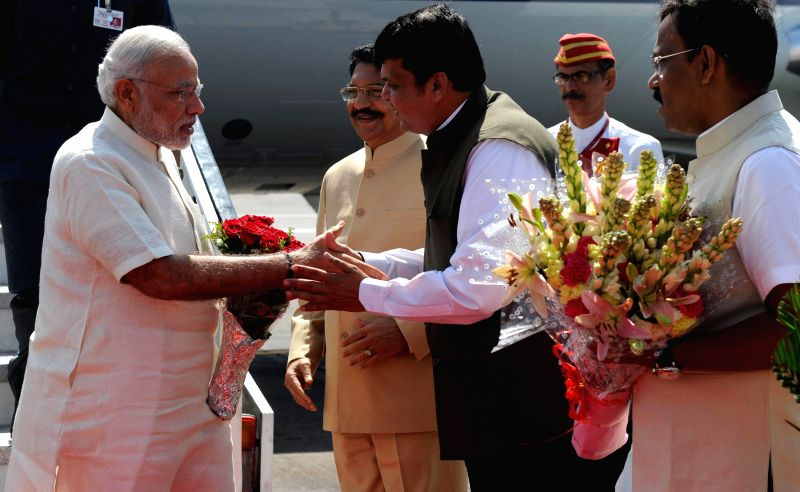Prime Minister Narendra Modi being received by the Governor of Maharashtra C. Vidyasagar Rao and Chief Minister Devendra Fadnavis on his arrival at Mumbai Airport on April 2, 2015. - Narendra Modi and C. Vidyasagar Rao