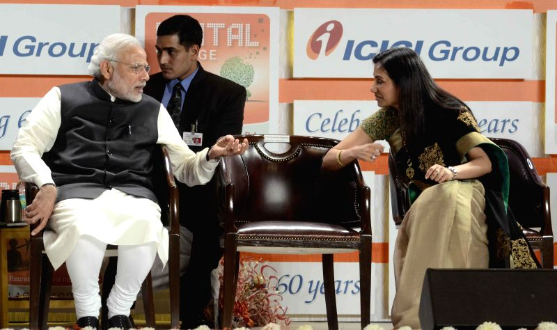 Prime Minister Narendra Modi being greeted by ICICI bank CEO Chanda Kochhar during a programme organised to celebrate 60th anniversary of ICICI Bank in Mumbai, on Jan 2, 2015. - Narendra Modi