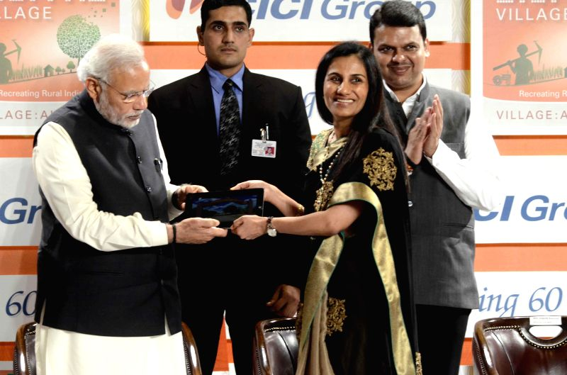 Prime Minister Narendra Modi being greeted by ICICI bank CEO Chanda Kochhar during a programme organised to celebrate 60th anniversary of ICICI Bank in Mumbai, on Jan 2, 2015. Also seen ... - Narendra Modi