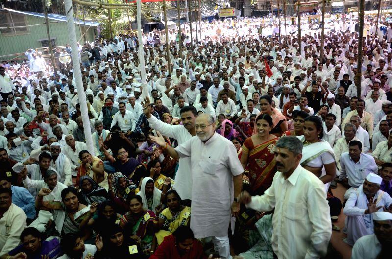 Prime Minister Narendra Modi's brother Pralhad Modi participates in a demonstration organised by  fair price dealers at Azad Maidan in Mumbai, on March 2, 2015. - Narendra Modi and Pralhad Modi