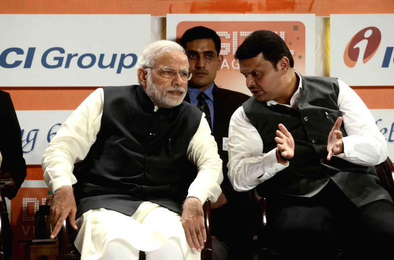 Prime Minister Narendra Modi with Maharashtra Chief Minister Devendra Fadnavis during a programme organised to celebrate 60th anniversary of ICICI Bank in Mumbai, on Jan 2, 2015. - Narendra Modi