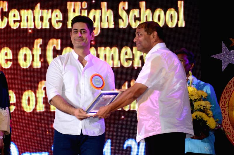 Principal Ajay Kaul with actor Mohit Raina during the 34th annual day celebration of Children`s Welfare Centre High School in Mumbai, on Feb 15, 2015. - Mohit Raina