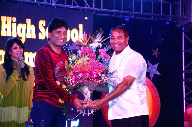 Principal Ajay Kaul with actor Raju Srivastav during the 34th annual day celebration of Children`s Welfare Centre High School in Mumbai, on Feb 15, 2015. - Raju Srivastav