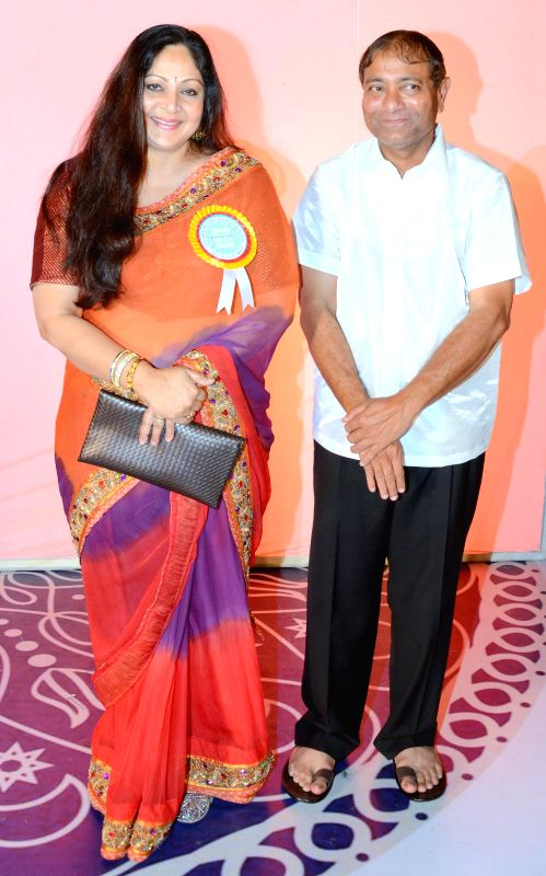 Principal Ajay Kaul with actress Rati Agnihotri during the 34th annual day celebration of Children`s Welfare Centre High School in Mumbai, on Feb 15, 2015. - Rati Agnihotri