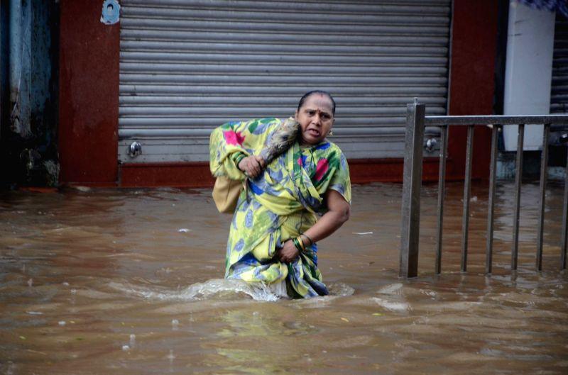 :Mumbai: Rains leave streets water-logged in Mumbai on June 9, 2018. (Photo: IANS).