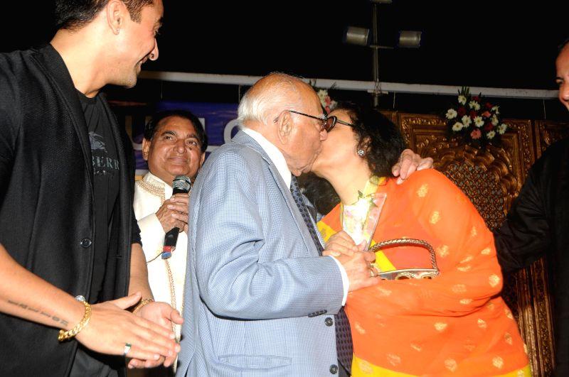 Ram Jethmalani lip smooched actress Leena Chandavarkar during Humlog Awards 2015 at Radio Club in Mumbai on Feb. 16, 2015.