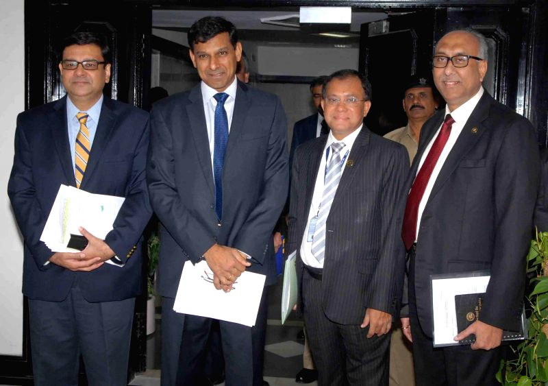 RBI Governor Raghuram Rajan and RBI Deputy Governors S S Mundra, H R Khan and Dr. Urjit Patel arrive to address a press conference in Mumbai, on Dec 2, 2014. - H R Khan and Urjit Patel