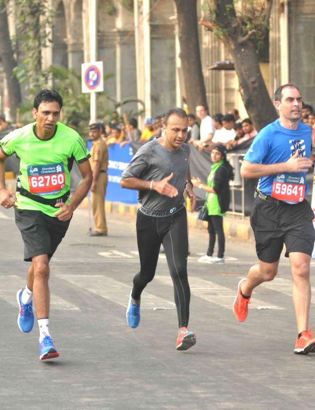 Reliance ADAG chairman Anil Ambani participates in Mumbai Marathon 2015 on Jan 18, 2015.
