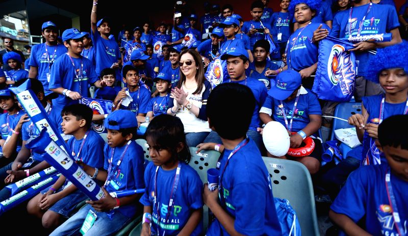 Reliance Foundation chairperson Nita Ambani with underprivileged children during an IPL-2015 match between Mumbai Indians and Sunrisers Hyderabad at Wankhede Stadium, in Mumbai, on April 25, ... - Nita Ambani