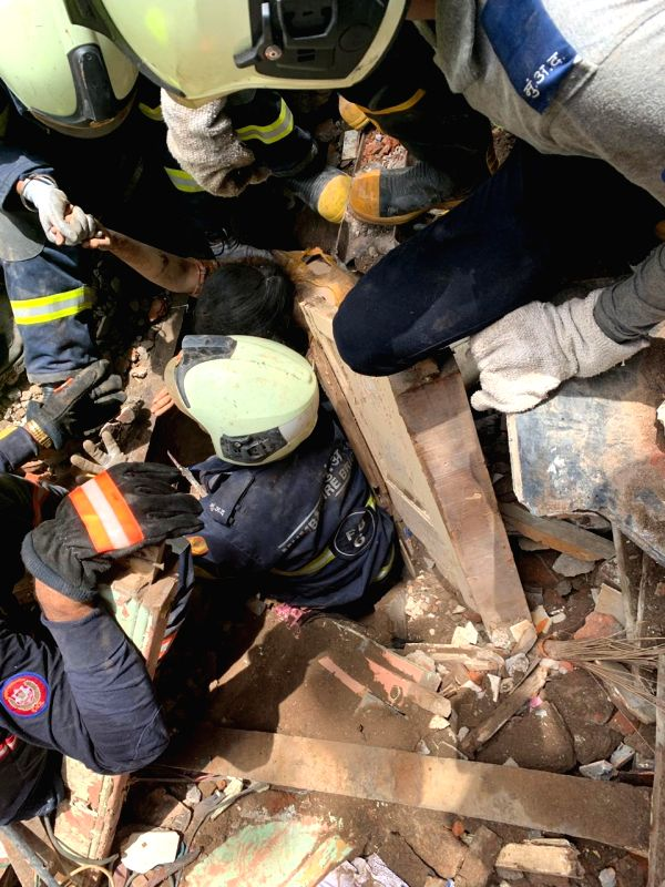 Mumbai: Rescue Operations underway at the site where a four-storey Kesarbai Building collapsed around 11.30 a.m in south Mumbai's Dongri area on July 16, 2019. Two people were killed and five others injured in the incident. According to officials, tw