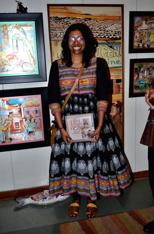 RJ May during opening of a cartoon gallery ``aPaulogy`` by Paul Fernandes in Mumbai on Dec 13, 2014.