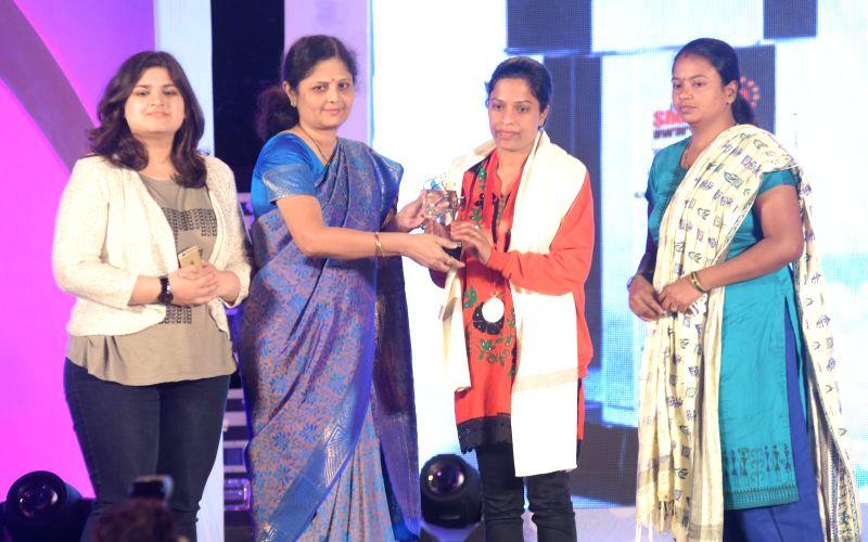 Rukhsar Kausar receiving award during the `Shoorveer Awards` in Mumbai on March 15, 2015.