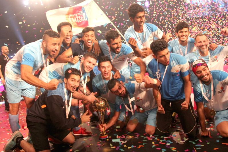 Mumbai's players celebrates with the trophy after winning the Premier Futsal League final match between Mumbai vs Kochi at Duler Stadium in Mapusa, Goa on July 24, 2016.