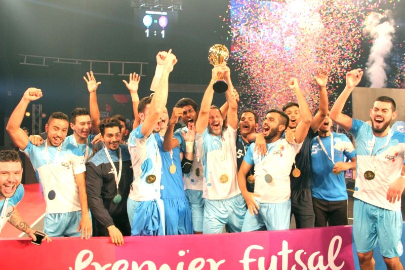 Mumbai's players celebrates with the trophy after winning the Premier Futsal League final match between Mumbai vs Kochi at Duler Stadium in Mapusa, Goa on July 24, 2016.