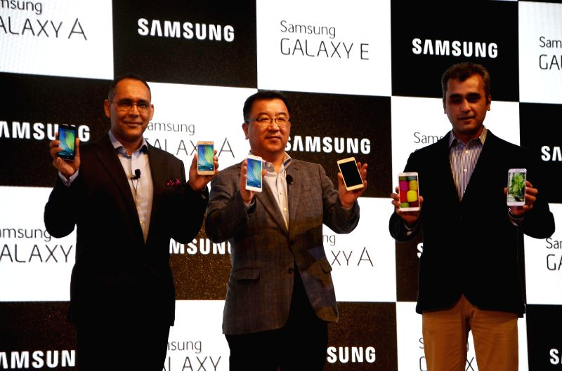 Samsung India, Mobile and IT, Vice president (Marketing) Asim Warsi, Samsung India, Mobile and IT, Senior Vice President Ken Kang and Samsung India, Mobile, Direction, Manu Sharma at the ... - Manu Sharma