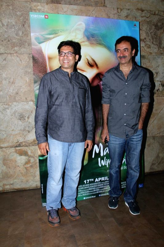 Screen play writer Abhijat Joshi and filmmaker Rajkumar Hirani during the special screening of film Margarita With A Straw in Mumbai on April 8, 2015. - Abhijat Joshi