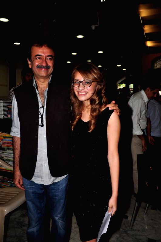 Screen play writer Abhijat Joshi`s daughter and author Anushka Joshi and filmmaker Rajkumar Hirani during the book lunch of `If Time Thinks` in Mumbai on April 29, 2015. - Abhijat Joshi and Anushka Joshi