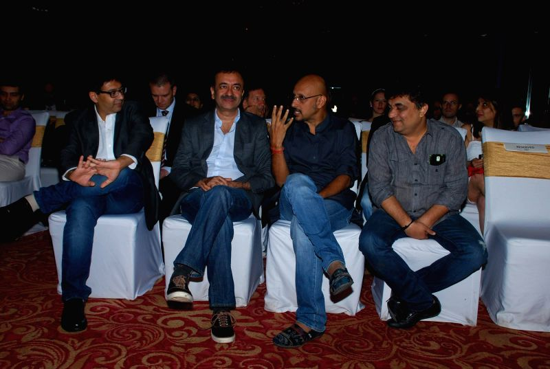 Screenwriter Abhijat Joshi, filmmaker Rajkumar Hirani, music composer Shantanu Moitra and lyricist Swanand Kirkire during presentation of film PK, in Mumbai on Nov 25, 2014. - Abhijat Joshi