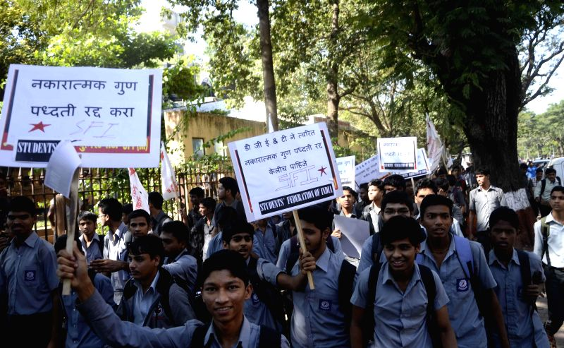 SFI activists stage a demonstration to press for their demands at Azad Maidan in Mumbai, on Dec 18, 2014.