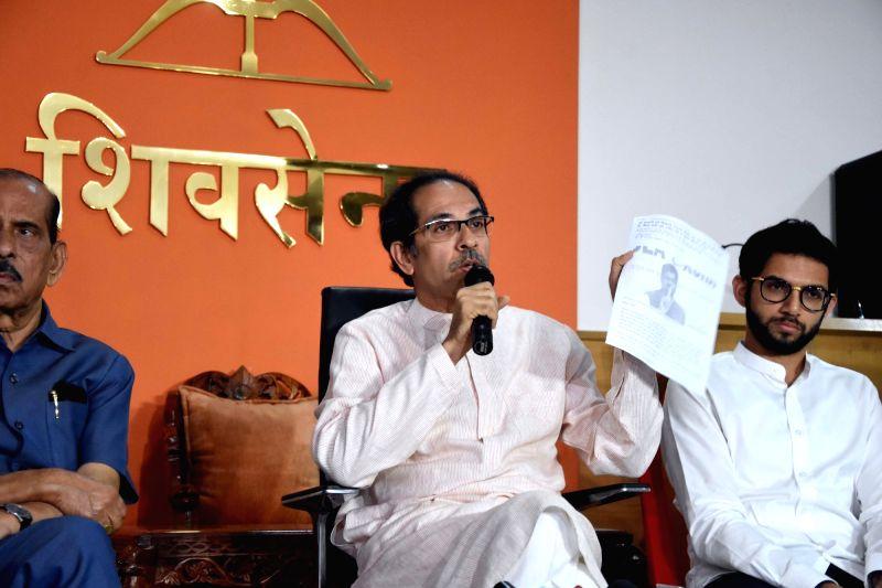 Mumbai: Shiv Sena chief Uddhav Thackeray addresses a press conference in Mumbai on Nov 8, 2019. Also seen Shiv Sena leaders Aaditya Thackeray. (Photo: IANS)