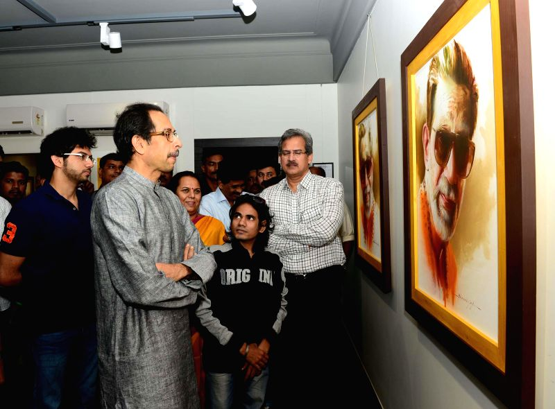 Shiv Sena chief Uddhav Thackeray and Yuva Sena chief Aditya Thackeray visit an art exhibition in Mumbai, on Jan 22, 2015.