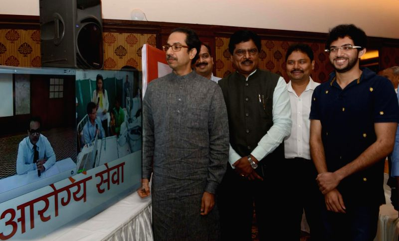 Shiv Sena chief Uddhav Thackeray during the launch of `Free Tele Medicine Service` for people residing in remote areas of Maharashtra in Mumbai on Feb. 2, 2015. Also seen Yuva Sena chief ... - Deepak Sawant