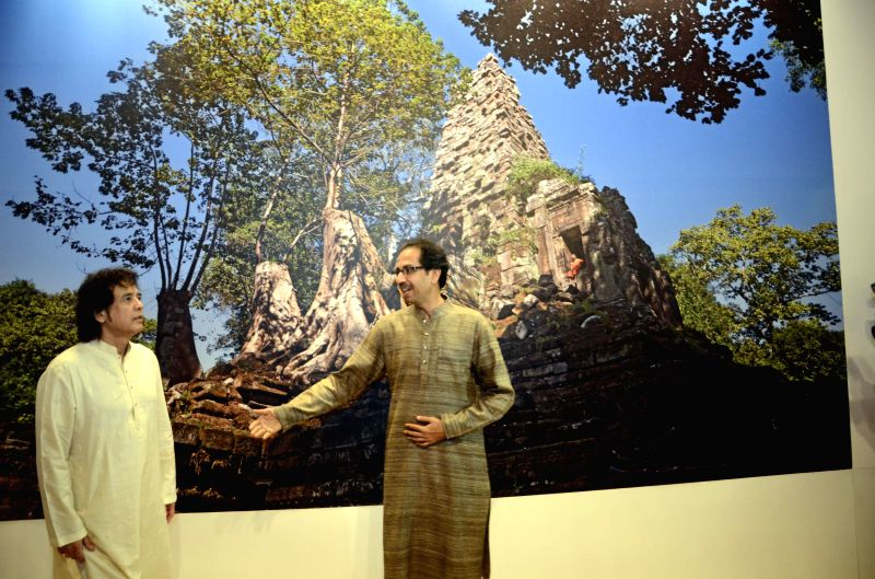 Shiv Sena Chief Uddhav Thackeray with tabla player Zakir Hussain at his photography exhibition organised to raise funds for drought affected farmers in Mumbai, on Jan 6, 2015.