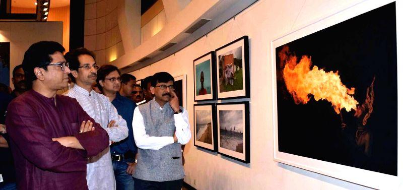 Shiv Sena Chief Uddhav Thackeray with Maharashtra Navnirman Sena (MNS) chief Raj Thackeray at his photography exhibition organised to raise funds for drought affected farmers, in Mumbai, on ..