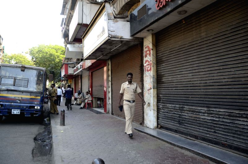 Shops in Girgaum-Kalbadevi keep their shutters down as the residents of the area call a strike to protest against a metro project passing through the area  in Mumbai on March 18, 2015. The ...