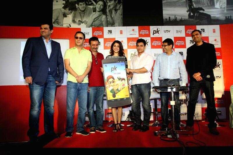 Siddharth Roy Kapoor, MD, Disney India, Filmmakers Vidhu Vinod Chopra and Raju Hirani, actors Anushka Sharma and Aamir Khan, launch the official mobile game PK, in Mumbai on Dec. 12, 2014. - Vidhu Vinod Chopra, Raju Hirani, Anushka Sharma, Aamir Khan and Siddharth Roy Kapoor