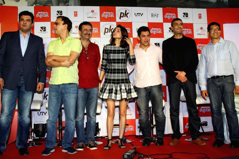 Siddharth Roy Kapoor, MD, Disney India, Filmmakers Vidhu Vinod Chopra and Raju Hirani, actors Anushka Sharma and Aamir Khan during the launch of official mobile game PK, in Mumbai on Dec. 12, - Vidhu Vinod Chopra, Raju Hirani, Anushka Sharma, Aamir Khan and Siddharth Roy Kapoor