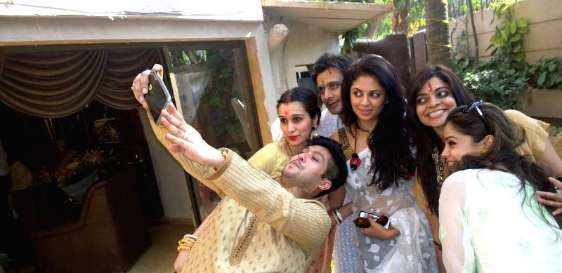 Singer Bappa Lahiri clicks a selfie with wife Tanisha, Agam Pandit, Kavita Kaushik, Nivedita Basu and Sumona Chakravorty at Bappi Lahiri`s Saraswati Puja at his residence in Mumbai on Jan 25, - Nivedita Basu