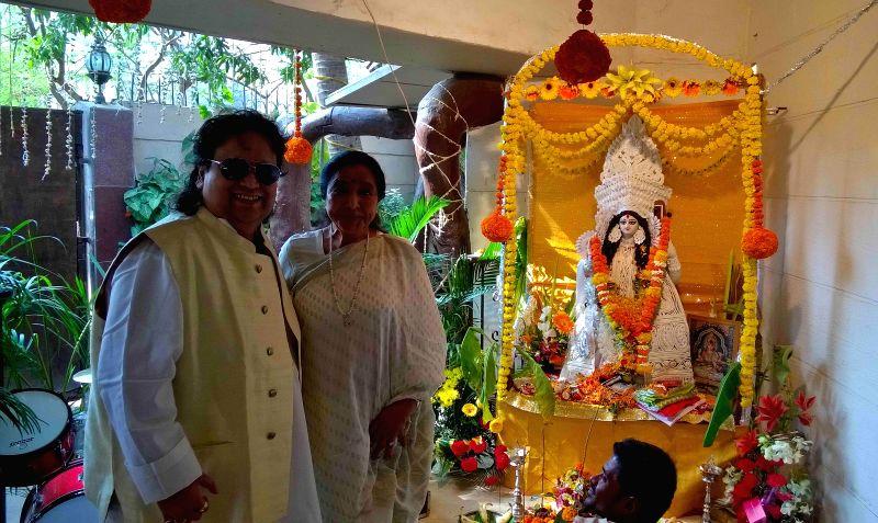 Singer Bappi Lahiri and Asha Bhosle at Bappi Lahiri`s Saraswati Puja at his residence in Mumbai on Jan 25, 2015. - Asha Bhosle